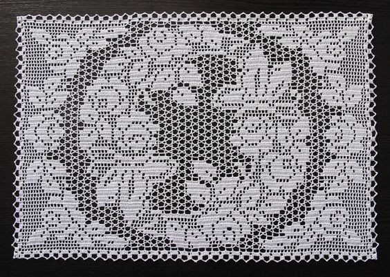 Filet crochet doily by vintage Laura Wheeler pattern (which Ive bought here, on Etsy) with roses and two butterflies. Two kinds of filet. 32x47 cm. You can use it as a centerpiece too. I have whole set of this pattern - two round doilies and a smaller rectangular doily.  Any questions, please, ask!  All my parcels are insured and has tracking number.
