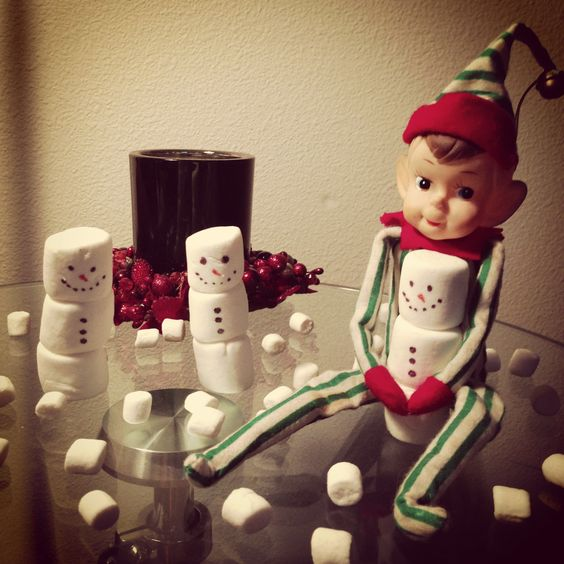 Sammy, our elf, built some snowmen. Elf on a Shelf