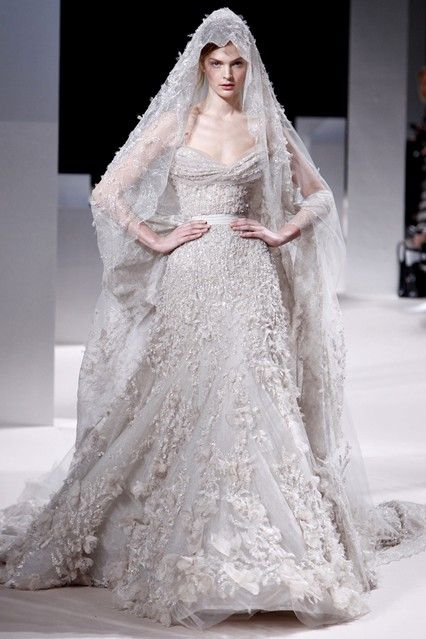 Elie Saab remove the stupid veil thingy and it would be just perfect....