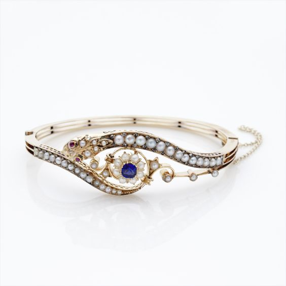 Late Victorian Diamond, Natural Pearl, Ruby and Blue Paste Serpent Bangle; Russian, circa 1880: