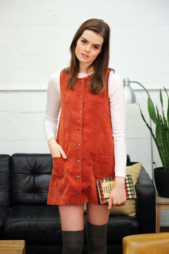 Twiggy burnt orange corduroy pinafore with copper toned snap fasteners: