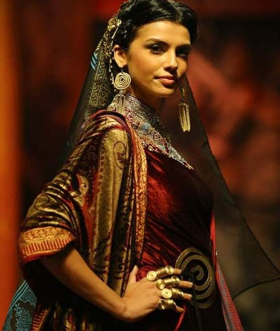 A model walks the ramp for Suneet Verma bridal wear at the India Bridal Fashion Week 2013.