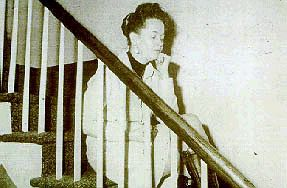 Lorraine collapsing in the Amityville house