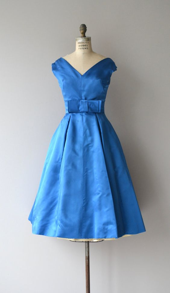 Vintage 1950s bright royal blue silk satin party dress with cap sleeves, center seamed bodice, fitted waist with wide bow sash belt, full skirt with