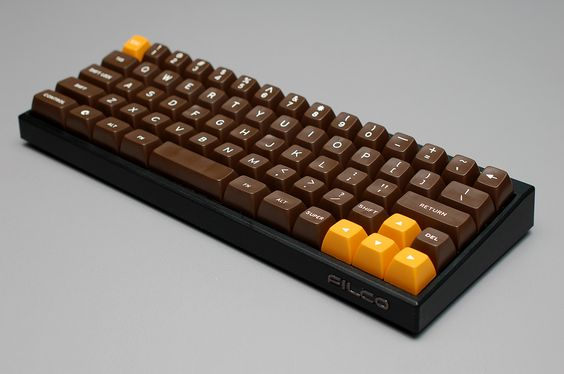 Filco MiniLa with Commodore 64C SA. The yellow keys came in an alternate function pack.
