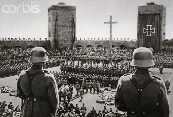 Adolf Hitler at Hindenburg's Funeral - AAEE001152 - Rights Managed - Stock Photo - Corbis. Adolf Hitler (lower center, walking) at the state funeral for President Paul von Hindenburg in August 7, 1934. Five days previous, when the President died, Hitler, the Chancellor, declared himself Fuhrer. | Location: Near Hohenstein, Germany.:
