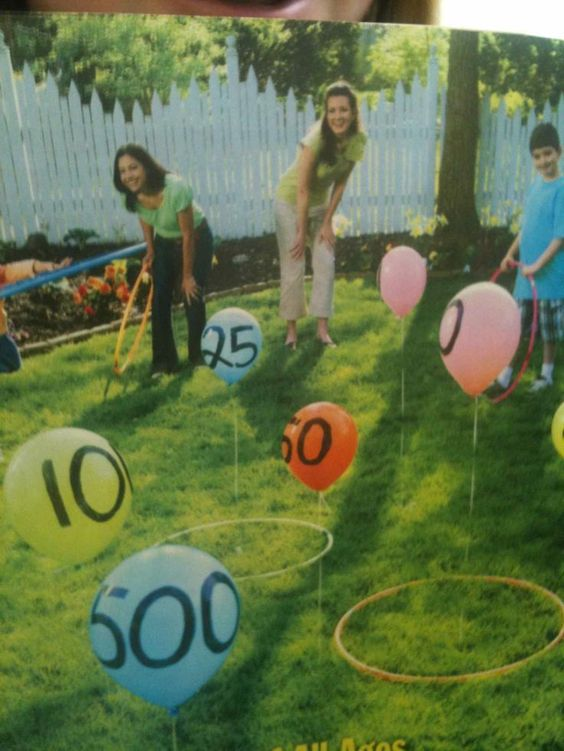 toss hula hoop over balloon game. Great outdoor party game for family reunions or backyard bbqs. Great for young kids learning to add, too