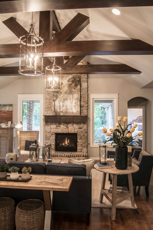 Transitional Living Room with High ceiling, metal fireplace, Carpet, Pendant light, Exposed beam, Hardwood floors: