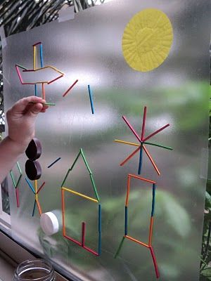 Clear contact paper with the sticky side out, taped to a window. Anything sticks... fun for a rainy day.: