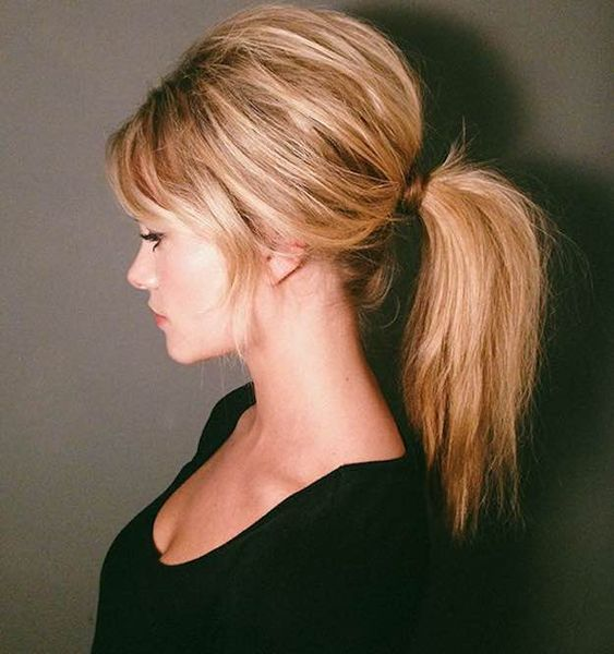 60s Ponytail   Long Hairstyles With Bangs to Embrace Your Inner Zooey Deschanel