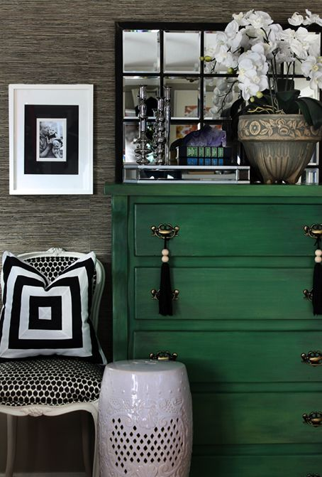 Painted chest ... blue or gray??? Or maybe just a colorful chair next to a wood grain chest