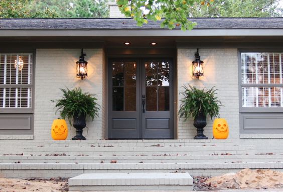 i really like the lighter grey/putty color on the brick, with the DARKER color (instead of white) on the door/trim/gutter/soffit/fascia, and a black roof. with black lighting fixtures. such a classy look. that would look great on your home.: