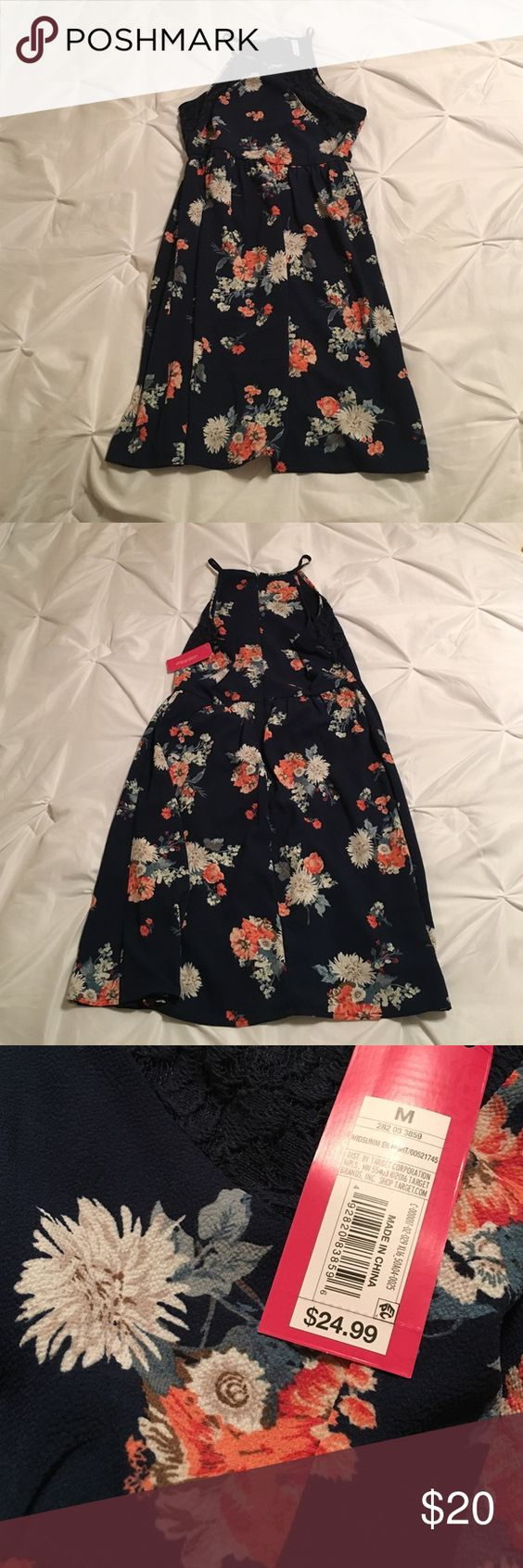 NWT floral dress NWT floral xhilaration dress  • just above knee length on me (I'm 5'6'' for reference) • zipper closure in back • halter neckline  • navy blue lining attached  •gathers at waist   this dress is perfect for any special occasion! Xhilaration Dresses