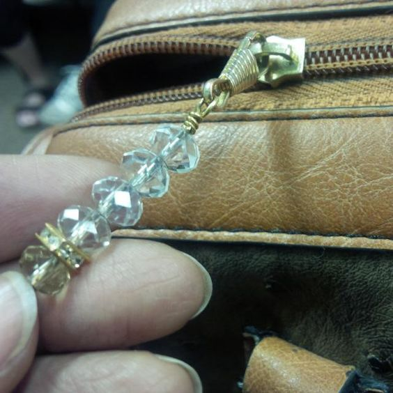 My #broken #zipper #pulltab was #replaced #repaired with @Zipsessory #zipper #jewelry #pendant #sophistication #stylish #fashion #purse #bags #crystals #bling