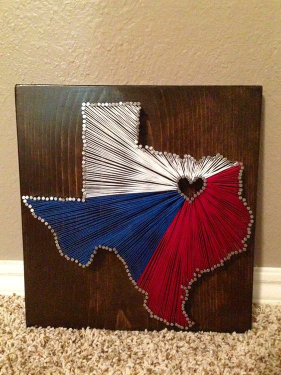 Texas String Art. Wooden stained boarded with red, white and blue Texas on it. Unique Texas gift