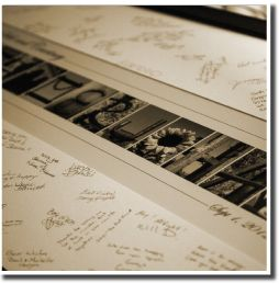 A photo of the signed guest book frame. Letter art by Spell-It-Out Photos