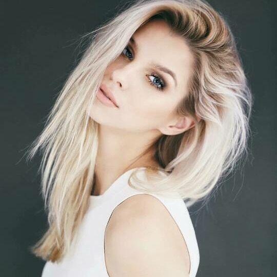 Dark roots and platinum blonde hair