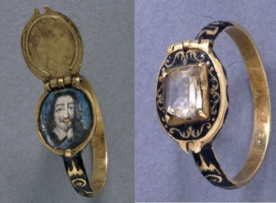 Finger-ring locket, gold, 17th century. shoulders with scrolls reserved on ground of black enamel; oval bezel opening as locket, containing enamelled portrait of Charles I with blue ground; lid has table diamond in square setting on ground with scrolls on black enamel; edges and back of bezel are also enamelled in black.  (British Museum, AF.1439)