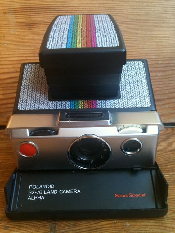 {rainbow knit reskinned SX70}. That's what I call be creative.