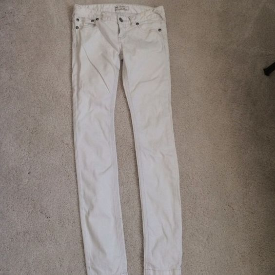 Free People white jeans White jeans. In good condition. Small creme/yellow colored stain near the belt loop. Not that noticeable and can be easily covered Free People Jeans