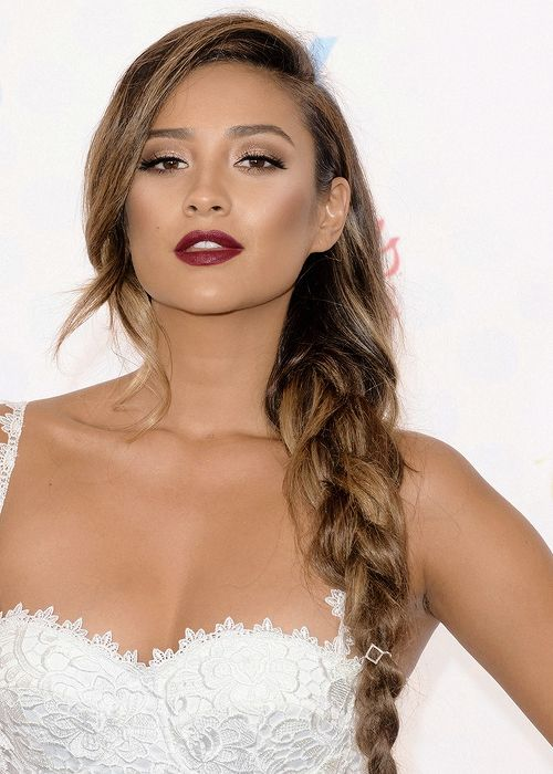 Shay Mitchell looks hot with a contoured face, dark lashes, and ox blood lips: