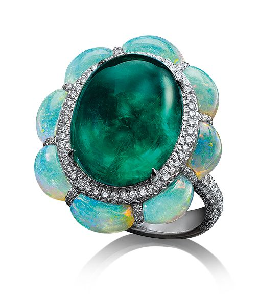 Cellini Jewelers. Cabochon Emerald Ring. Cabochon emerald ring, framed with paved diamonds and half moon shaped opals. Set in 18-karat white gold.