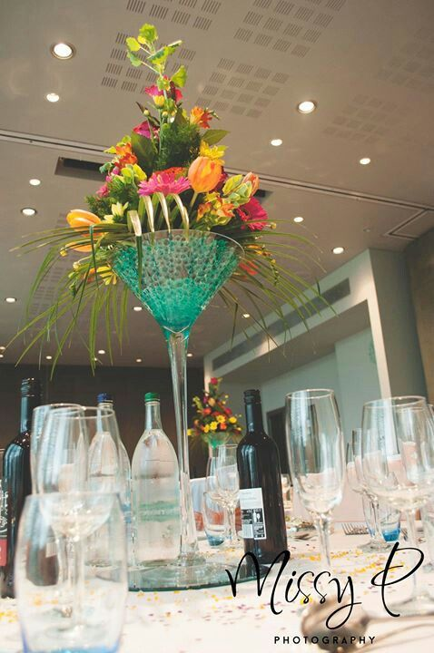 Gorgeous table centres in large martini glasses