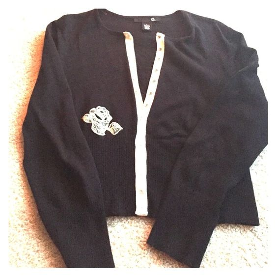 Black and white cardigan with lace detail Snap closure in the front, great condition. Beautiful white lace flower detail both front and back Sweaters Cardigans