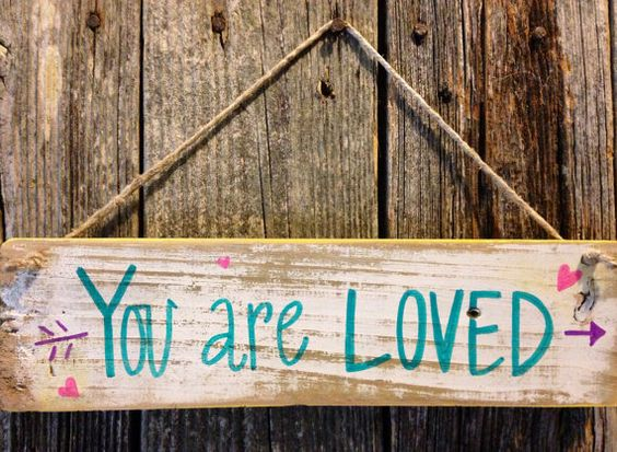 Distressed white, yellow, pink, and turquoise YOU ARE LOVED wood hanging sign  on Etsy, $14.00