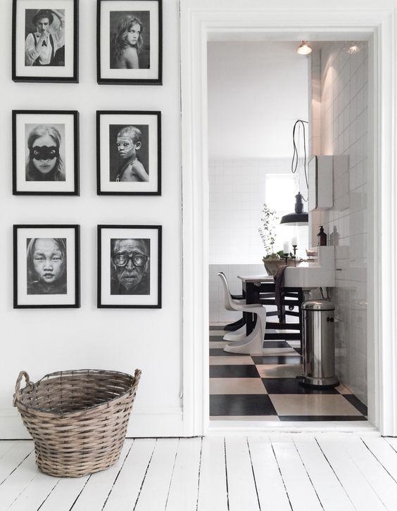 Black frames. Large white mattes. B&W photos.