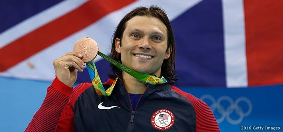 Cody Miller poses on the podium at the medal ceremony for the men's 100-meter breaststroke at the Rio 2016 Olympic Games at the Olympic Aquatics Stadium on Aug. 7, 2016 in Rio de Janeiro