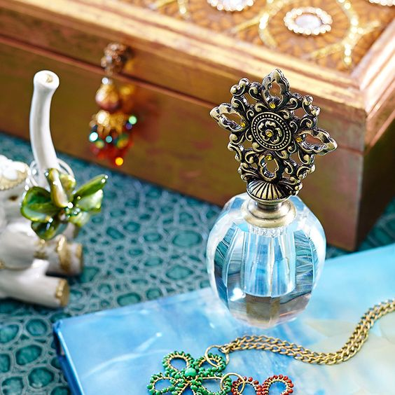 Two subtle romantic touches: A dab of perfume behind the ears and this Gem Perfume Bottle on your dresser.