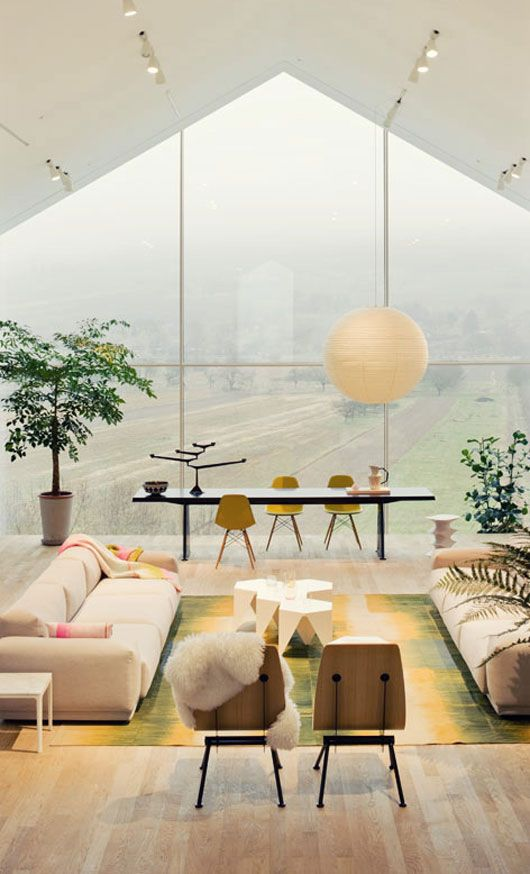 bright living room + nature - love the rug!!