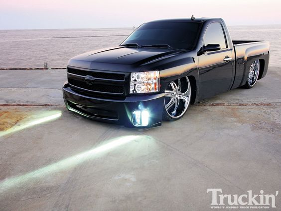 2008 Chevy Silverado slammed with a bag suspension. I would do this to my truck but it would render it almost useless in shitty weather. Better keep it lifted for now lol.