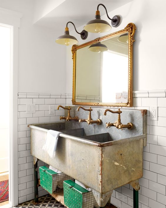 New brass faucets turned this farm sink into a stylish wash station.: