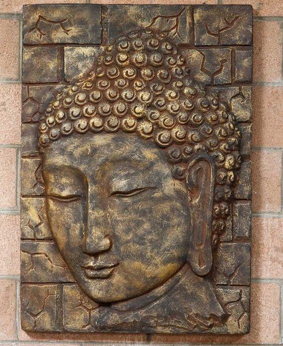 Large handmade buddha wall panel hangings on the