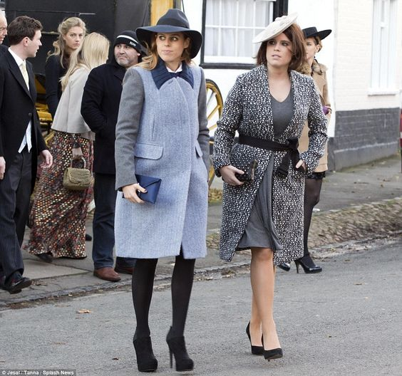 Beatrice and Eugenie at a wedding Beatrice IDs: Carven coat, Wilbur&Gussie clutch and Philip Treacy hat. Eugenie IDs: UFO coat (but possibly by Fendi), UFO clutch, L.K.Bennett pumps and Juliette Botterhill hat.