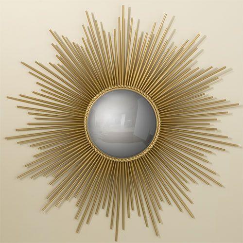 Gold sunburst mirror.