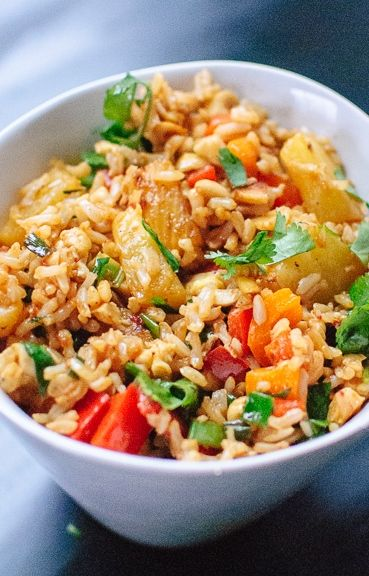 Thai-style sweet and spicy pineapple fried rice with red bell pepper, cashews and cilantro.