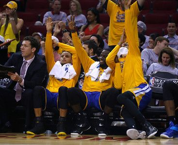 Description of . The Golden State Warriors bench, including Golden State Warriors' Stephen Curry (30) and Golden State Warriors' Draymond Green (23) celebrate a 3-point basket by a teammate during their game against the Houston Rockets late in the fourth quarter of Game 3 of the NBA Western Conference finals at the Toyota Center in Houston, Texas, on Saturday, May 23, 2015. (Nhat V. Meyer/Bay Area News Group)