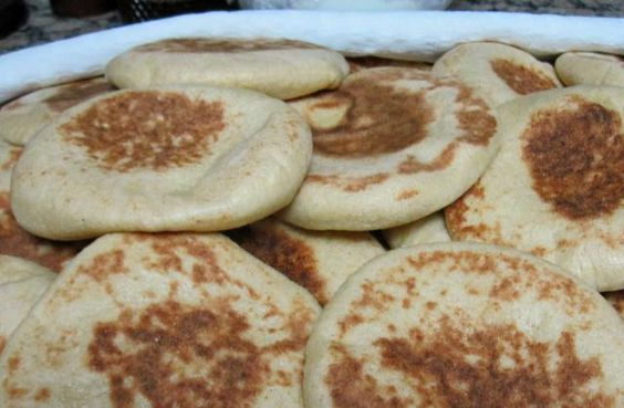 These popular Moroccan breads are cooked on the stove rather than in the oven. Once you try them, you'll want to make them again and again.