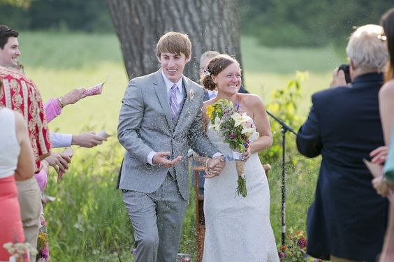 This farm wedding has lavender themes all over, even the aisle confetti is dried lavender!