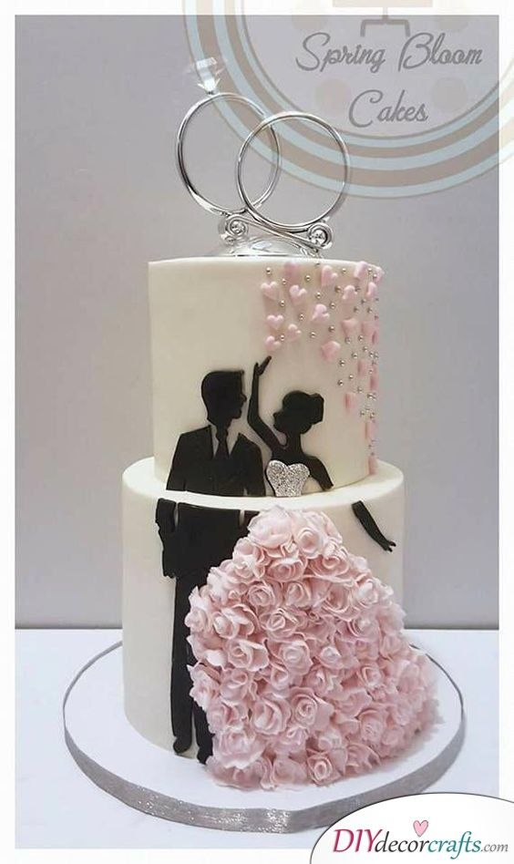 Wedding Rings Top Off The Cake With This Idea Spring Wedding Cake Wedding Cakes With Flowers Silhouette Cake