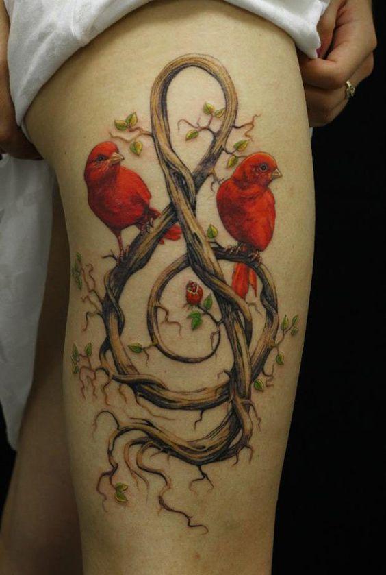 tatouage-jambe-oiseux-branche-cle-musique