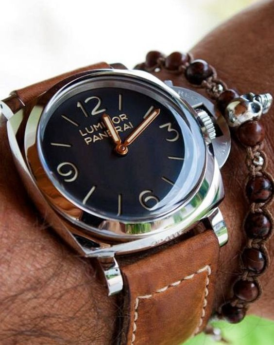 Men's watch by Panerai is simple with a twist. The black face brings a modern element to this classic accessory, & the skull bracelet adds a little punk rock flair.