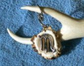 This Scorpio symbol is carved in a Deer Burl and attached to a key ring,but it can be converted to a necklace.