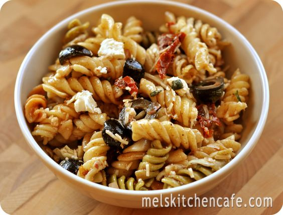 Mediterranean Pasta Salad. Delicious and light with Balsamic, Sun Dried Tomatoes, Olives, Artichokes & Feta.
