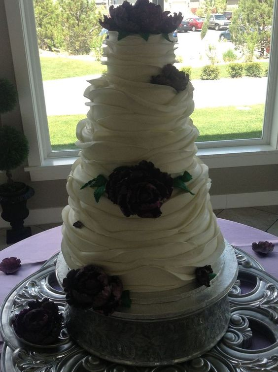 5 tiers covered in mmf ruffles with gum paste peonies.  A word to the wise..... Don't cover in fondant then add ruffles, makes for 150 pound cake....  My favorite flower so far!