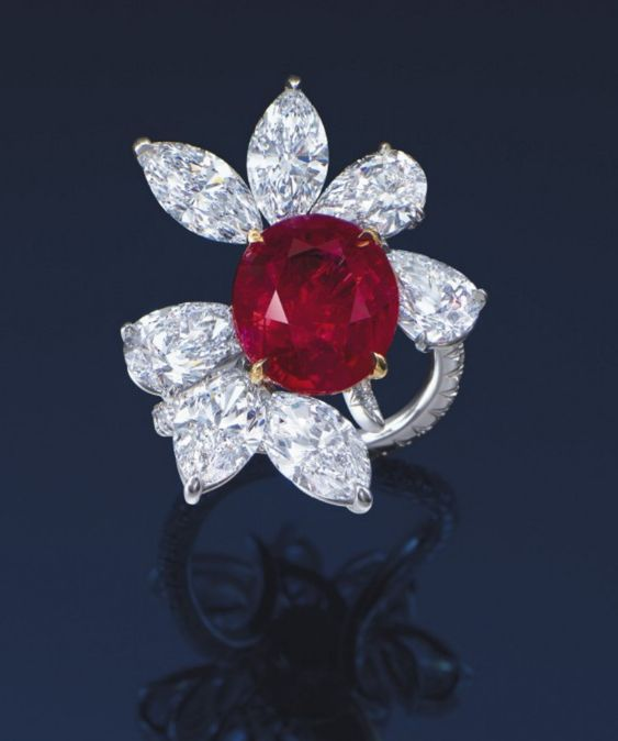 A MAGNIFICENT RUBY AND DIAMOND RING, BY JAMES W. CURRENS FOR FAIDEE