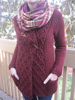 This sweater flatters everyone--a stunning cabled front, shortened sleeves and deep pockets, it can be wrapped, folded and styled to suit anyone!